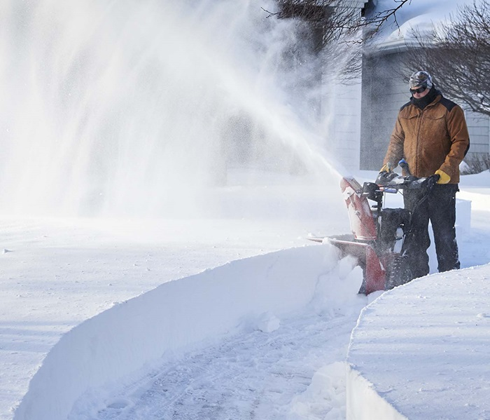 Minimize clogging and maximize speed with the Toro Power Max two-stage snow blower.